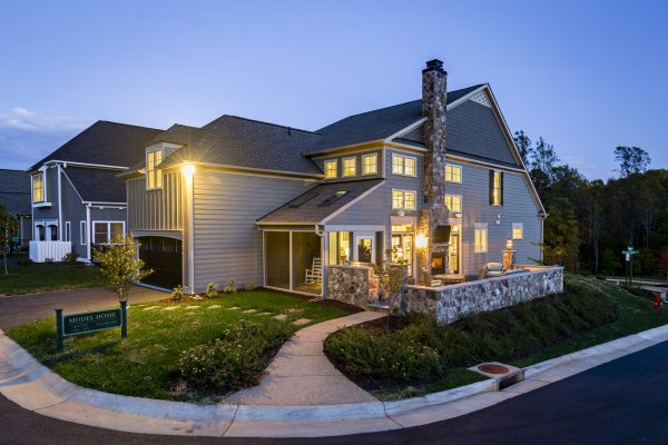 Exterior of Craig Builders model home in Old Trail Village in the evening.