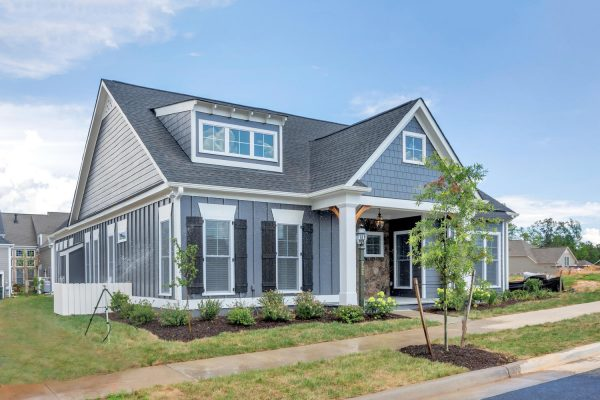 New construction home in Charlottesville VA built by Craig Builders with a first floor master suite in a cottage craftsman style