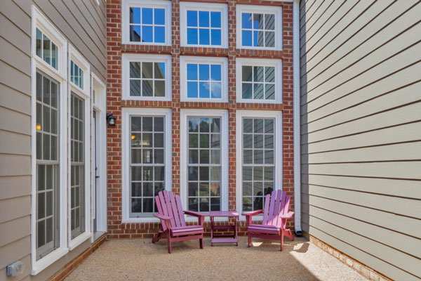 Large bank of windows with outdoor seating in The Avondale Courtyard.