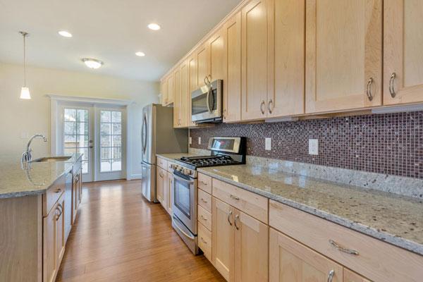 Kitchen in The Pavilion with tiled back-splash.