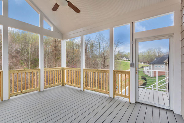 Screened in rear porch on The Pavilion with ceiling fan and view of nature.