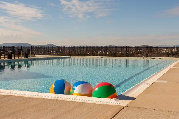 Cascadia swimming pool with beach balls.