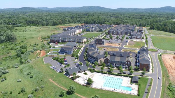 Aerial view of Old Trail Village with pool in foreground