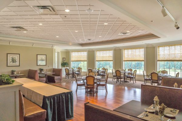 Dining area in Glenmore Community with view out the windows